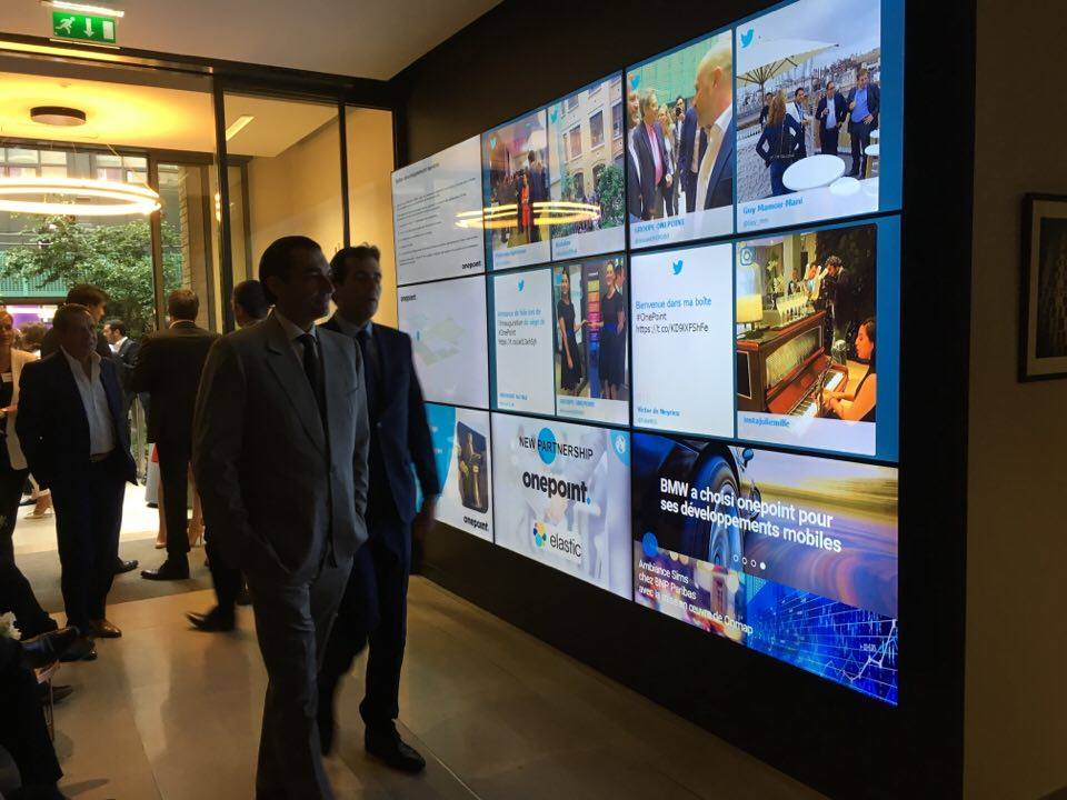 The Onepoint Group used a social wall on screens to celebrate the opening of their new headquarters